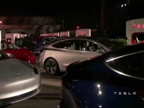 Tesla delivers first of its lower-cost Model 3 cars